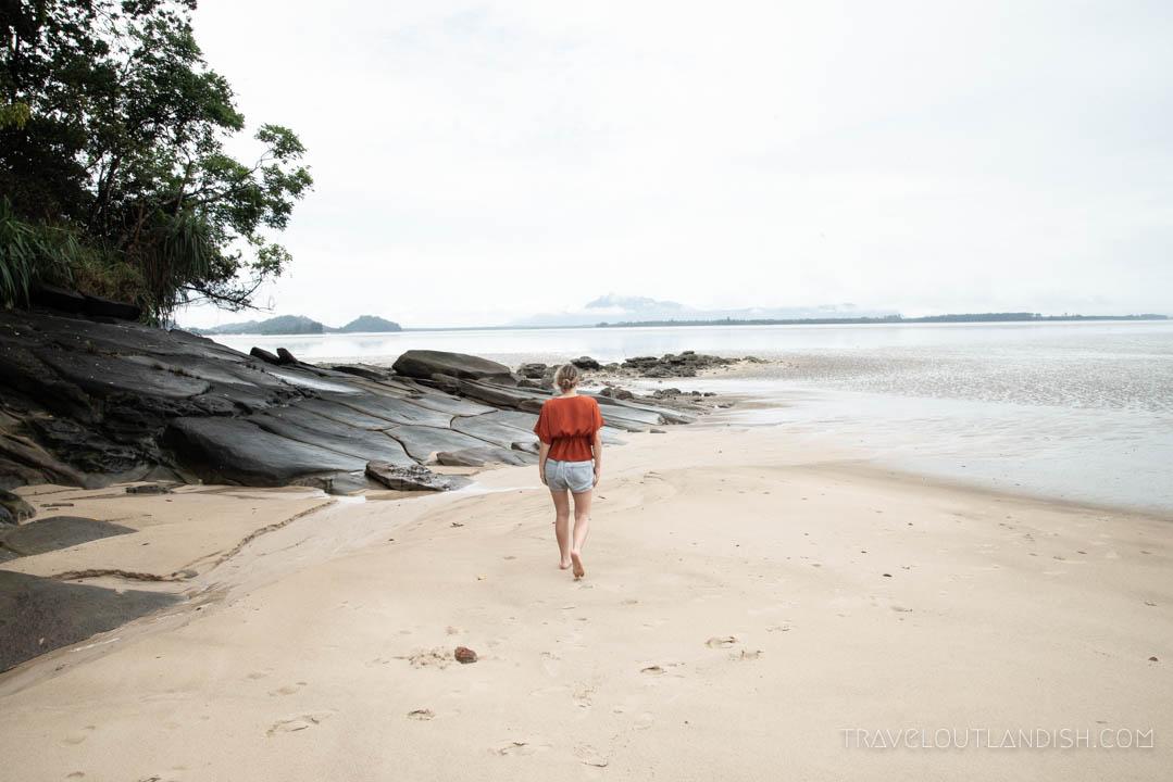 The Culvert - Woman Walking Down the Beach