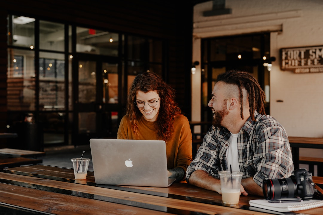 Friends on a laptop in a workspace
